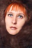 Girl with fur coat. Studio portrait Stock Photo