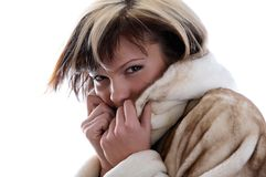 Girl in fur coat on white background Royalty Free Stock Photos