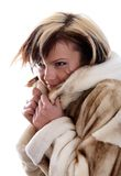 Girl in fur coat on white background Stock Photography