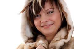 Girl in fur coat on white background Stock Images