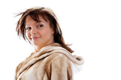 Girl in fur coat on white background Royalty Free Stock Photography