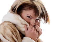 Girl in fur coat on white background Royalty Free Stock Images