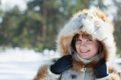 Girl in fur coat at wintry park Stock Photo
