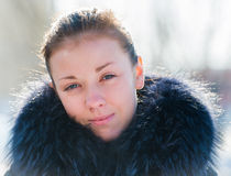 Girl in a fur collar Stock Image