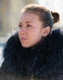 Girl in a fur collar Royalty Free Stock Photos