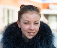 Girl in a fur collar Royalty Free Stock Images