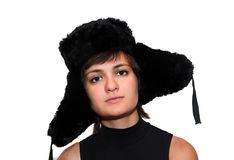 Girl in a fur hat. Young girl wearing russian traditional fur hat Stock Photography