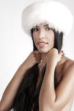 Girl in fur hat Royalty Free Stock Images