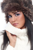 Girl in fur hat Stock Photos