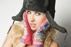Girl in a fur hat Royalty Free Stock Image