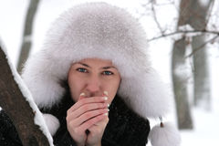 Girl with fur hat. Under the snow Stock Photo