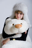 Girl in a fur hat with a bear Stock Photo