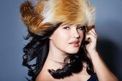 Girl in fur hat Royalty Free Stock Photography