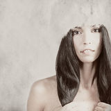 Girl in a fur hat over grunge background Stock Photo