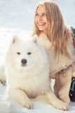 Girl with samoed dog Royalty Free Stock Images