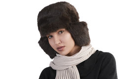 Girl with fur hat and with scarf looking stock images