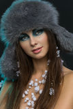 Girl in fur hat with snow. Portrait of beautiful girl in fluffy fur hat with snow Stock Photo