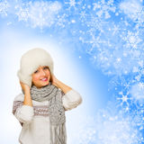 Girl in fur hat on winter background Royalty Free Stock Images