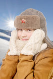 Girl with a fur hat and woolen gloves Royalty Free Stock Photos