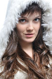 Girl in fur hat Stock Images