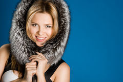 Girl with fur on head Royalty Free Stock Photography