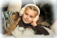 Girl in fur headphones Stock Images