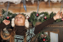 Girl in fur headphones Stock Image