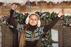 Girl in fur headphones Royalty Free Stock Photo