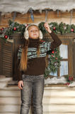 Girl in fur headphones Royalty Free Stock Photos