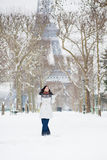 Girl in fur hood walking near the Eiffel tower in Pari Stock Photos