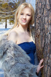 Girl in fur outdoors Stock Image