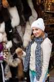 Girl at Fur Shop Royalty Free Stock Image