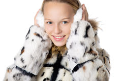 Girl in furry earmuffs Stock Images