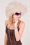 Girl in furry hat and glasses Royalty Free Stock Images