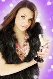 Girl in furs  holds Martini Stock Images
