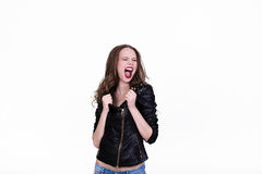 Girl in a fury. Girl in a black leather jacket shouting in a rage Stock Images