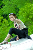 Girl on fuselage plane royalty free stock images