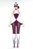 Girl in futuristic clothes. Brown hair model in futuristic clothes studio shot Royalty Free Stock Photos