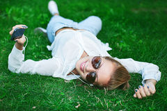 Girl with gadget Stock Photos