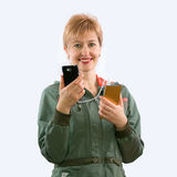 The girl and gadgets Stock Images