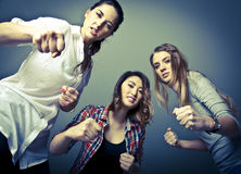 Girl Gang. Three cruel girls beating their victim Royalty Free Stock Images