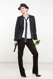 Girl gangster holding a gun. Classic suit and hat. Stock Images