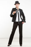 Girl gangster holding a gun. Classic suit and hat. Royalty Free Stock Image