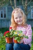 Girl in garden. Smile little girl in garden Royalty Free Stock Photography