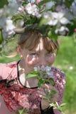Girl in the garden. Teen girl near blossoming apple-tree Stock Photo