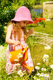 Girl in  garden Royalty Free Stock Image