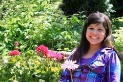 Girl in garden Royalty Free Stock Photo