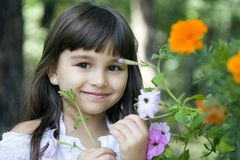 Girl in garden Stock Images