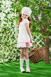 Girl in the garden with a basket in his hands Stock Photography