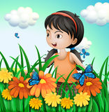 A girl in the garden with butterflies Royalty Free Stock Photography